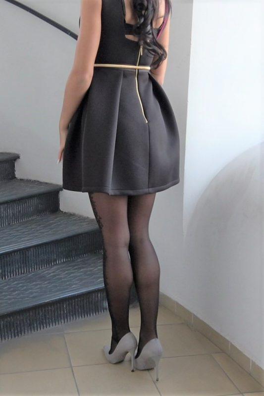 black pantyhose super legs model in high heels black mini dress 245